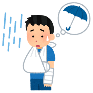 体の不自由さに傘をさせず悩む男性