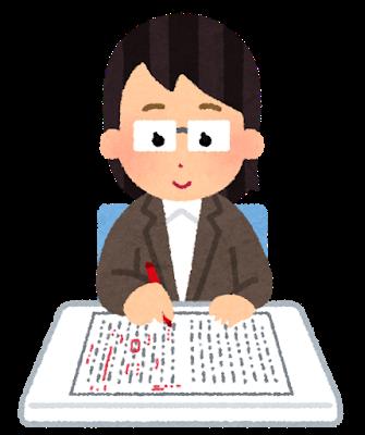 日本語のテストの採点をしている様子
