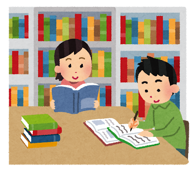 本に囲まれた空間で学ぶ人たち