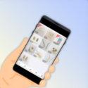 フリマアプリの画面を表示するスマートフォン